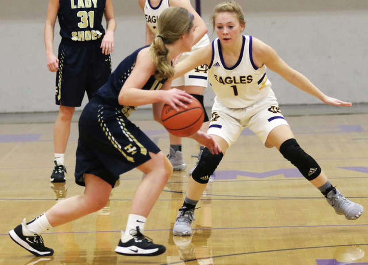 Civic Memorial's Tori Standefer (1) defends against a Teutopolis ballhandler during a Jan. 13 girls basketball game in Bethalto. Standefer, a starter since her freshman year, returns for her senior season with the Eagles after averaging 9.2 points per game as a junior.
