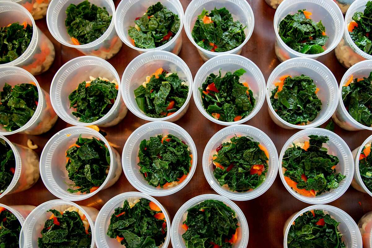Hundreds of containers are seen filled with the ingredients for chicken minestrone soup at FOB Kitchen. Delivery, takeout and nonprofit orders have sustained restaurants that must limit or stop indoor dining during the pandemic.