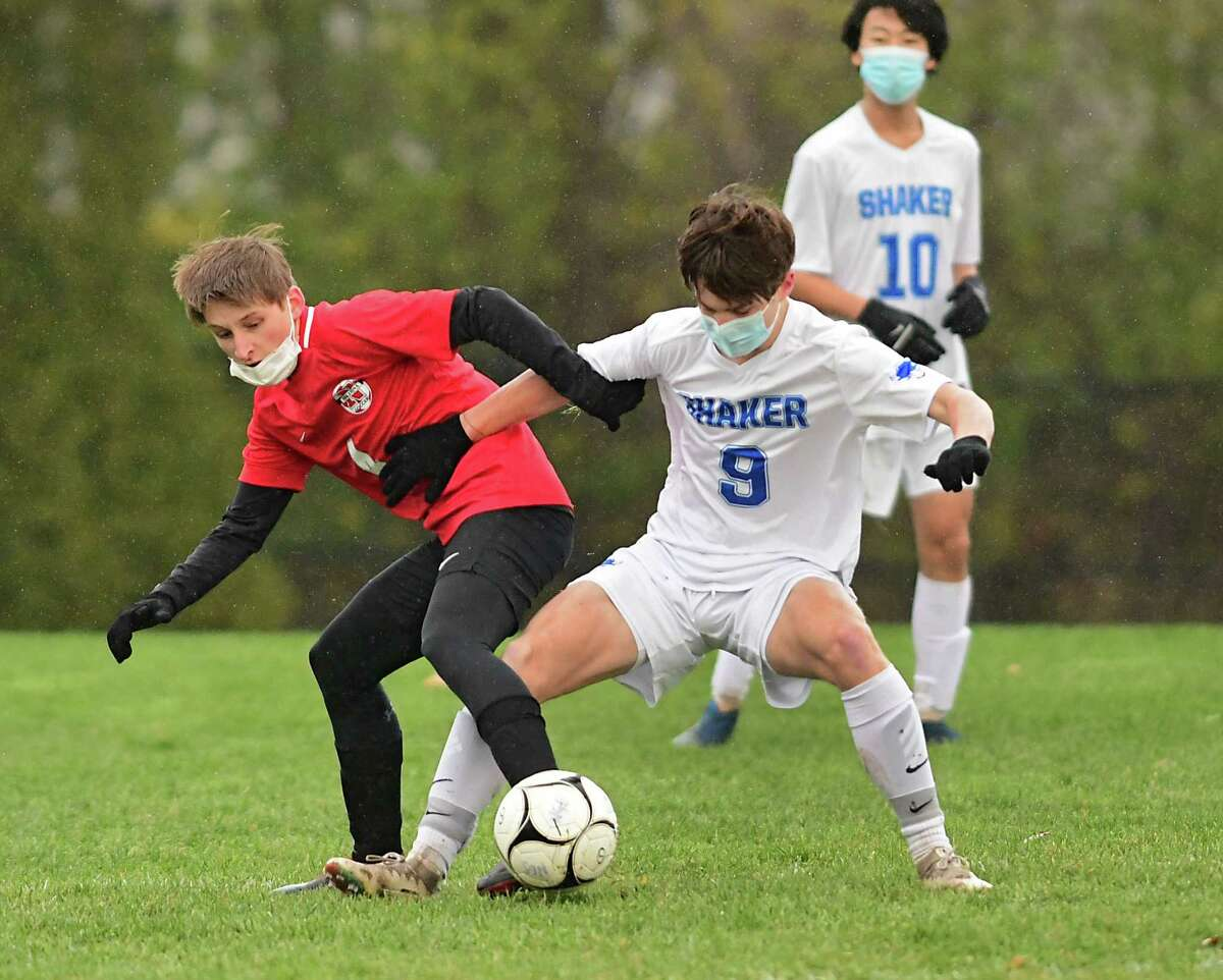 Niskayuna's Braeden Richards, left, battles with Shaker's Colin Brant during the Suburban Council boys' soccer quarterfinal on Tuesday, Nov. 17, 2020 in Niskayuna, N.Y. (Lori Van Buren/Times Union)