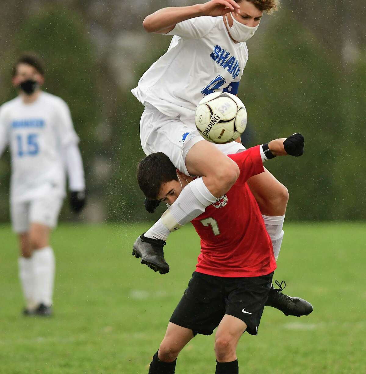 Shaker's Logan Drake ends up on top of Niskayuna's Matt Stiles as they battle for the ball during the Suburban Council boys' soccer quarterfinal on Tuesday, Nov. 17, 2020 in Niskayuna, N.Y. (Lori Van Buren/Times Union)
