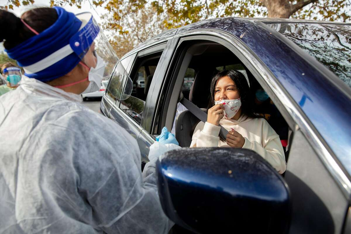 Carolina Archundia, 13, a Pittsburg resident, is tested for Covid-19 along with her family during the Testing for Turkey Media Conference and testing at a Covid-19 testing site in Concord, Calif. on Tuesday, Nov. 17, 2020.