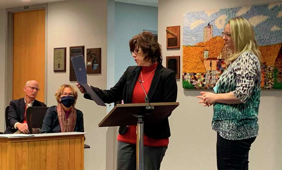 Jenifier Boyer (right), was presented with a certificate of recognition from the Michigan Emergency Management Association during a meeting of the Midland County Board of Commissioners on Tuesday. Boyer was nominated by Midland County administrator/controller Bridgette Gransden (center). (Mitchell Kukulka/Mitchell.Kukulka@mdn.net)