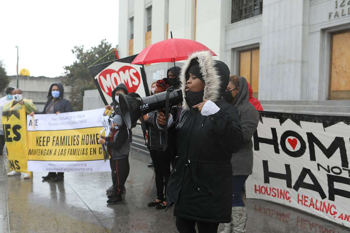 Moms 4 Housing co-founder and Councilwoman-elect Carroll Fife speaks at the courthouse after a march.