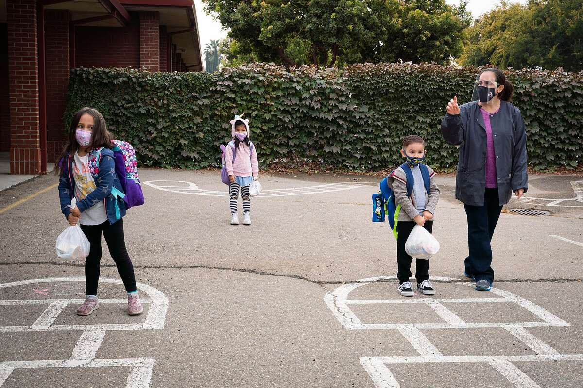 Kindergartners wait to be picked up after a morning session at Brock Elliott Elementary in Manteca, San Joaquin County.