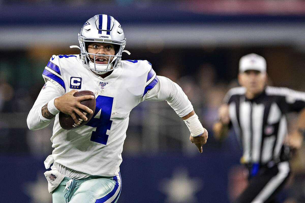 Dak Prescott of the Dallas Cowboys runs the ball during a game on Thanksgiving Day in 2019.