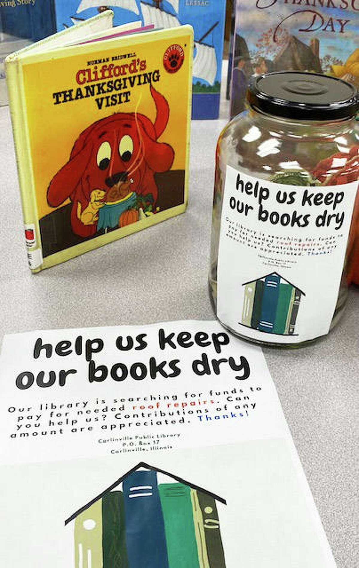 """""""Help Us Keep Our Books Dry"""" is a theme in the Carlinville Public Library's drive to seek funding to offset the cost of a new roof. The library's share of the cost of the roof could be as high as $80,000, and could affect the library's budget for years to come. A GoFundMe page has also been set up for donations to the project, and residents are also invited the GoFundMe link on social media."""