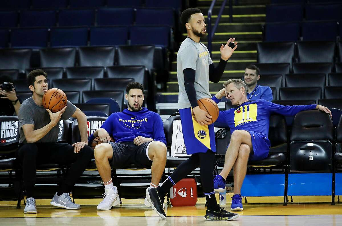 Warriors general manager Bob Myers, Klay Thompson, Stephen Curry and head coach Steve Kerr are at a practice during the 2019 NBA Finals.