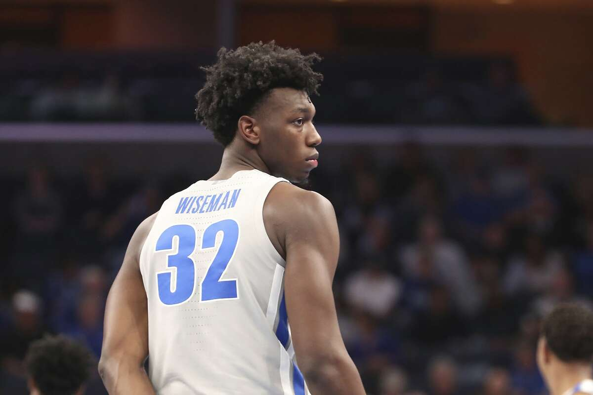 Memphis' James Wiseman (32) pauses between plays in an NCAA college basketball game against University of Illinois-Chicago Saturday, Nov. 9, 2019, in Memphis, Tenn.The Golden State Warriors selected Wiseman with the number two pick in the NBA Draft on Wednesday, Nov. 18, 2020.