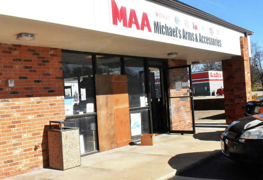 Michael's Arms & Associates, 439 S. Buchanan St., sustains damage to its storefront where suspects allegedly smashed the glass pane to gain entry to the business during a burglary Monday night in Edwardsville. Photo: Matt Kamp | The Intelligencer
