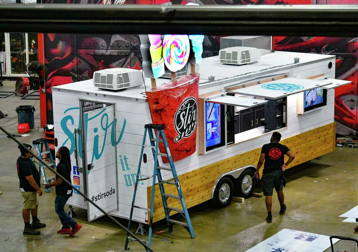 A crew at Cruising Kitchens works on the Stir Soda food truck. Operating under the radar, the company works with everyone from mom-and-pop operators to large companies like Whataburger and Raising Cane's.