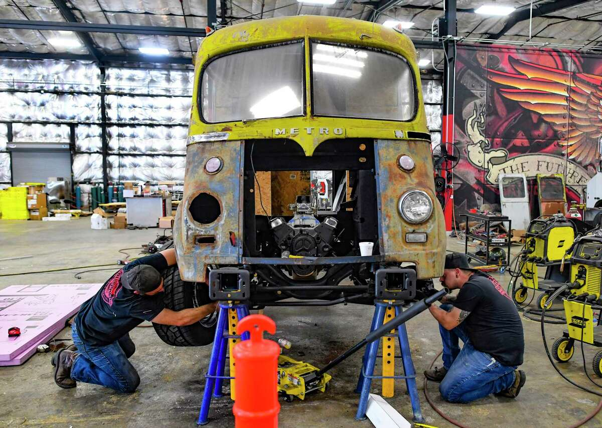 Employees work on a food truck conversion at Cruising Kitchens in 2020.