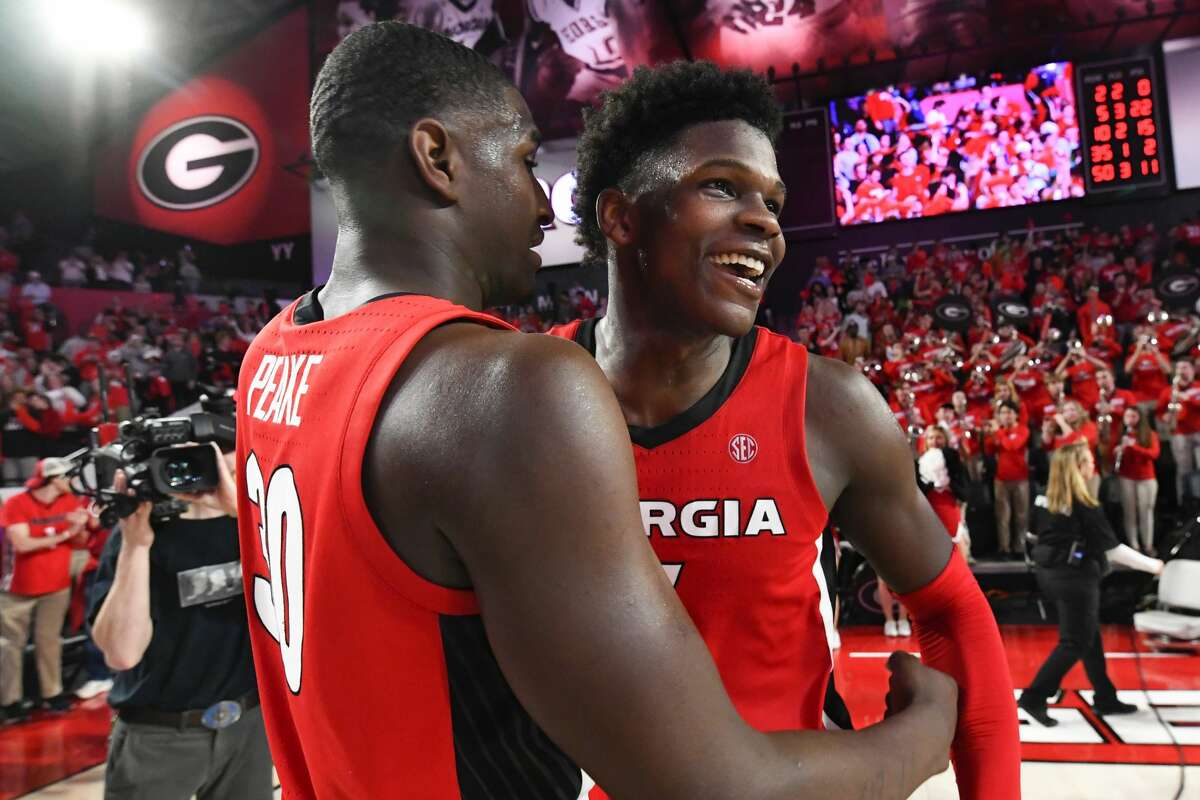 In this Feb. 19, 2020, file photo, Georgia guard Anthony Edwards, right, and forward Mike Peake celebrate after an NCAA college basketball game against Auburn. Edwards was selected to the Associated Press All-SEC first team. (AP Photo/John Amis, File)