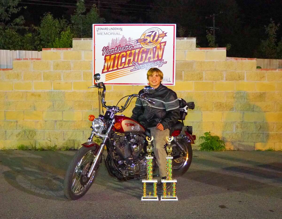 Kevin Dean is shown at the Northern Michigan Dragway behind several trophies. According to Dean's obituary, he loved drag racing and was recently named high school champion at the Northern Michigan Dragway, in Kaleva.