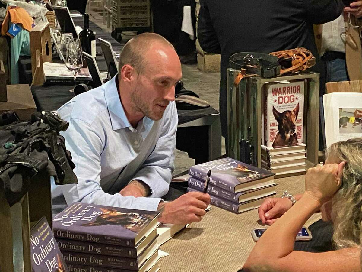 Will Chesney, former Navy SEAL, signs copies of his book at the Warrior Health Foundation gala on Nov. 16.