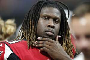 FILE - In this Aug. 17, 2018, file photo, Atlanta Falcons defensive end Takk McKinley (98) sits on the bench during the second half of an NFL preseason football game against the Kansas City Chiefs, in Atlanta. Defensive end Takk McKinley may have jeopardized his future with the Falcons by using social media to complain about not being traded. (AP Photo/John Bazemore, File)