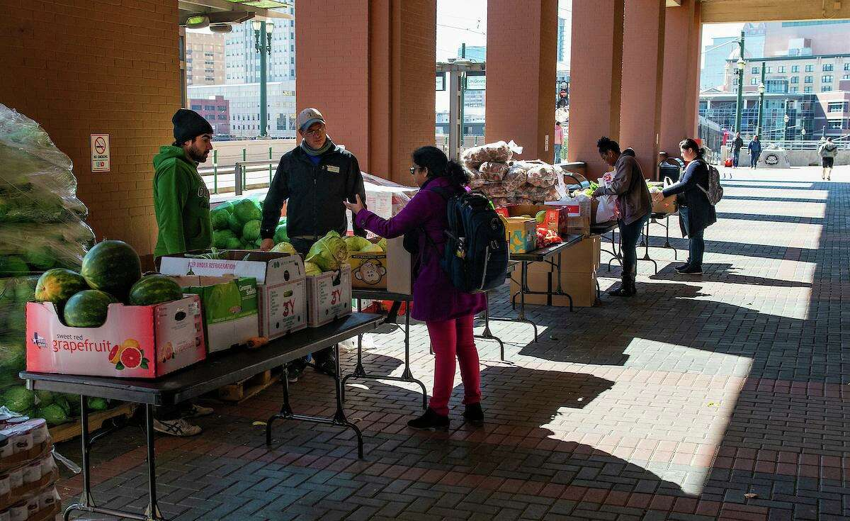 3/6/19: The Food Bank delivers food to the food pantry and gives out free food under the portico.