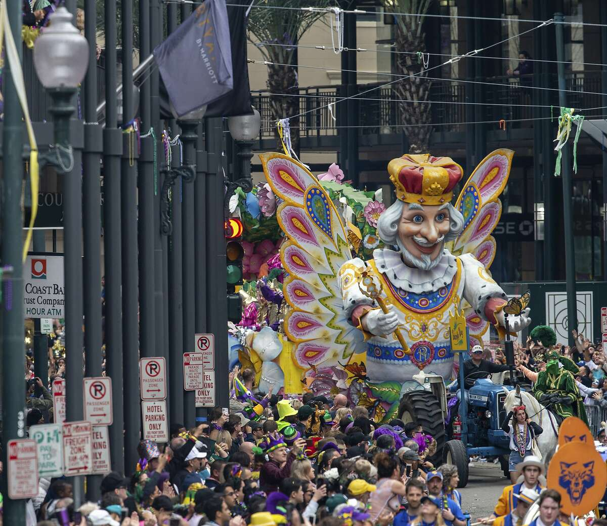 FILE - In this Feb. 25, 2020, file photo, the Butterfly King float makes it way down St. Charles Ave. near Canal Street as Rex rolls on Mardi Gras Day in New Orleans. There won't be any parades on Mardi Gras or during the weeks leading up to it because they just can't fit within restrictions to slow the spread of the coronavirus pandemic, a city spokesman said Tuesday, Nov. 17, 2020, The 250-person cap on outdoor crowds is