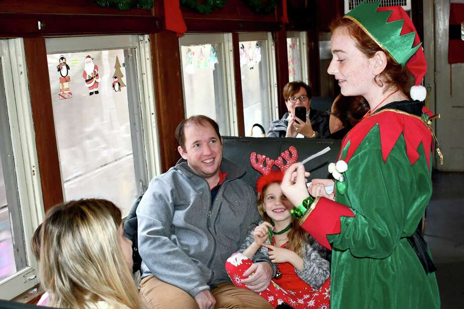 The Railroad Museum of New England is hosting a Toys for Tots collection train drive, in conjunction with the U.S. Marine Corps Reservists. Above, families enjoy a train ride and visit from Santa and his elves in 2018. Photo: Lara Green-Kazlauskas / For Hearst Connecticut Media /
