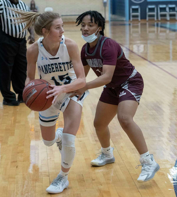 Greenwood's Karsyn Payton looks to pass as Lee High's Alyssa Green defends 11/17/2020 at the Greenwood High gym. Tim Fischer/Reporter-Telegram