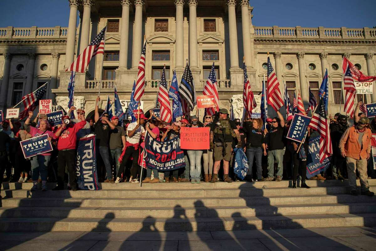 FILE - Supporters of President Donald Trump gather at the Pennsylvania State Capital in Harrisburg, Penn., Nov. 7, 2020. Even before he was elected in 2016, Trump was building a conspiracy theory about voter fraud that took on new energy this year, as his political fortunes ebbed during the coronavirus pandemic. (Victor J. Blue/The New York Times)