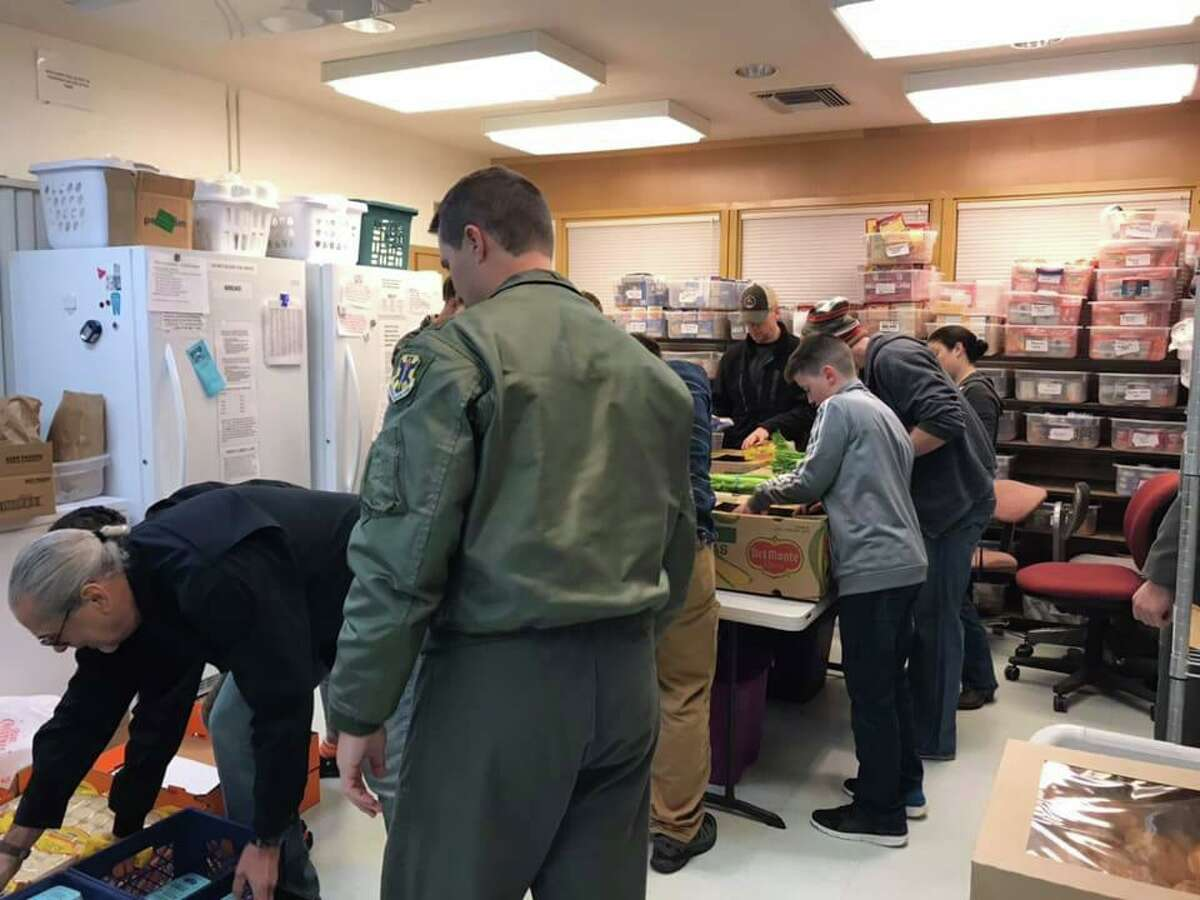 Volunteers gather in the Randolph Area Christian Assistance Program's food pantry to assemble packages that were part of a previous RACAP Christmas Holiday Meal Basket Program effort.