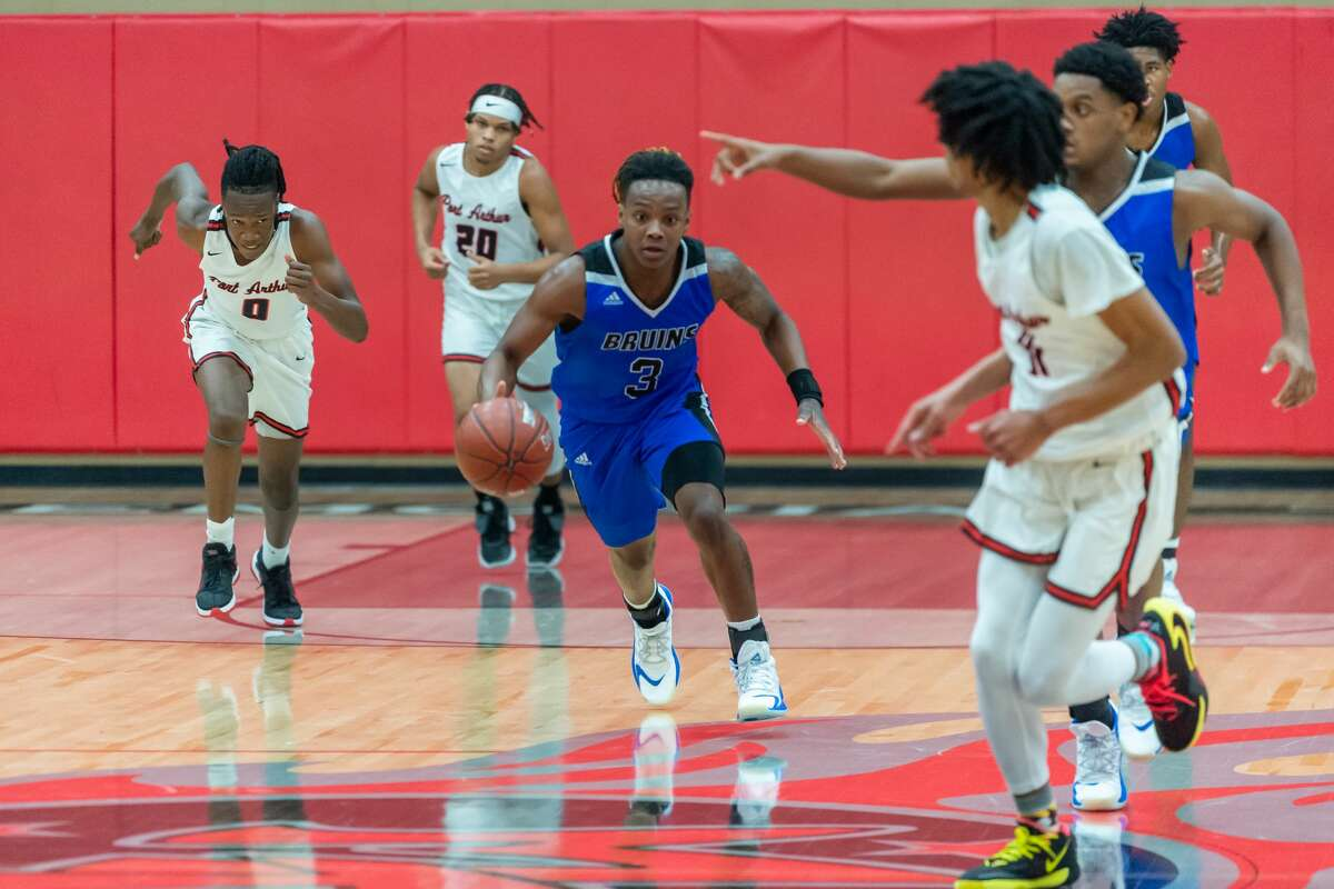 Bruins' Ja'Quan Yates (3) brings the ball up court in the second quarter. The West Brook Bruins squared off with the Titans of Port Arthur Memorial is a basketball shootout on Tuesday night. Photo made on November 17, 2020. Fran Ruchalski/The Enterprise