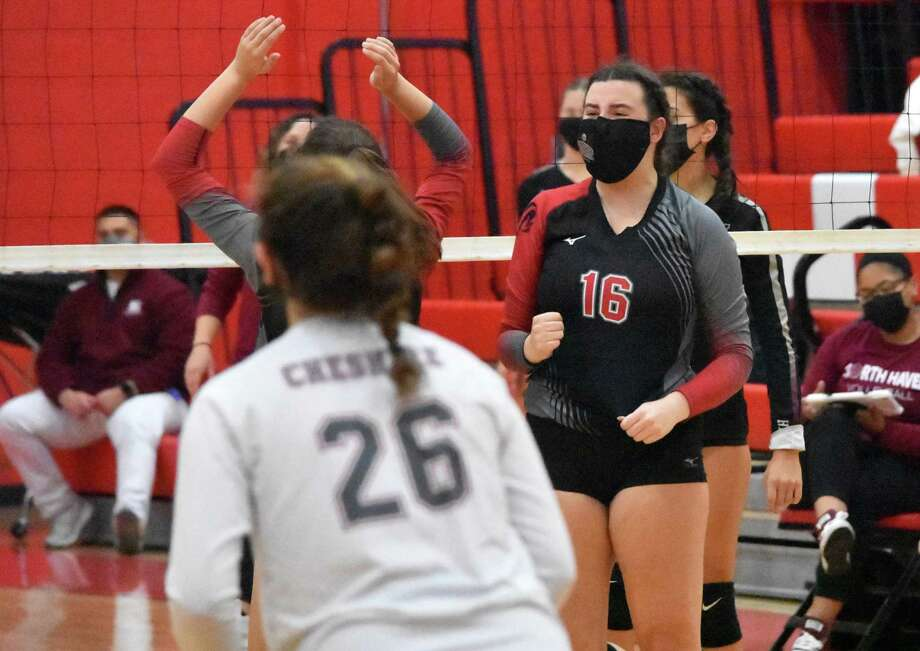 Cheshire's Sarah Holley celebrates after blocking a ball against North Haven in the SCC Division B final. Photo: Pete Paguaga / Hearst Connecticut Media