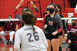 Cheshire's Sarah Holley celebrates after blocking a ball against North Haven in the SCC Division B final.