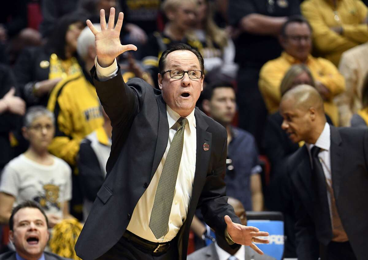 FILE - In this March 16, 2018, file photo, Wichita State head coach Gregg Marshall reacts during the first half of a first-round NCAA college basketball tournament game against Marshall in San Diego. Marshall resigned Tuesday, Nov. 17, 2020, following an investigation into allegations of verbal and physical abuse, ending a tenure that soared to the Final Four and crashed on the eve of the upcoming season. (AP Photo/Denis Poroy, File)
