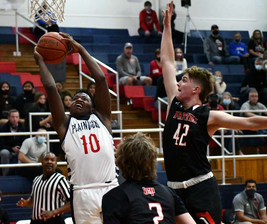 Plainview's Zaeq'won Riddley draws a foul on Lubbock-Cooper defender Caden Cline during their non-district boys basketball game on Tuesday, Nov. 17, 2020 in the Dog House at Plainview High School. Photo: Nathan Giese/Planview Herald