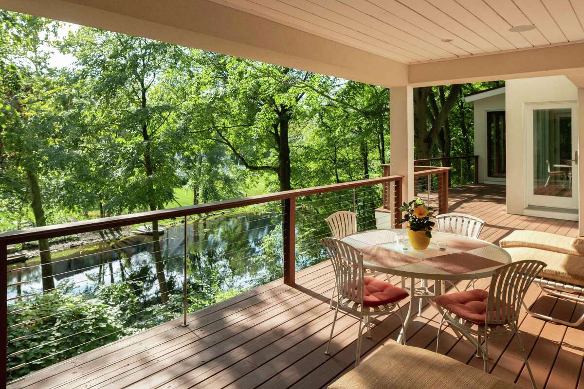 Two large decks looking over the Saugatuck River provide venues for relaxation and al fresco dining.