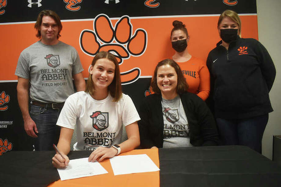 Edwardsville senior Gabbi Trauernicht, seated left, will play field hockey at Belmont Abbey College in North Carolina. She is joined by her family and EHS coach Jaimee Phegley and EHS assistant coach Meredith Beck. Photo: Matt Kamp|The Intelligencer