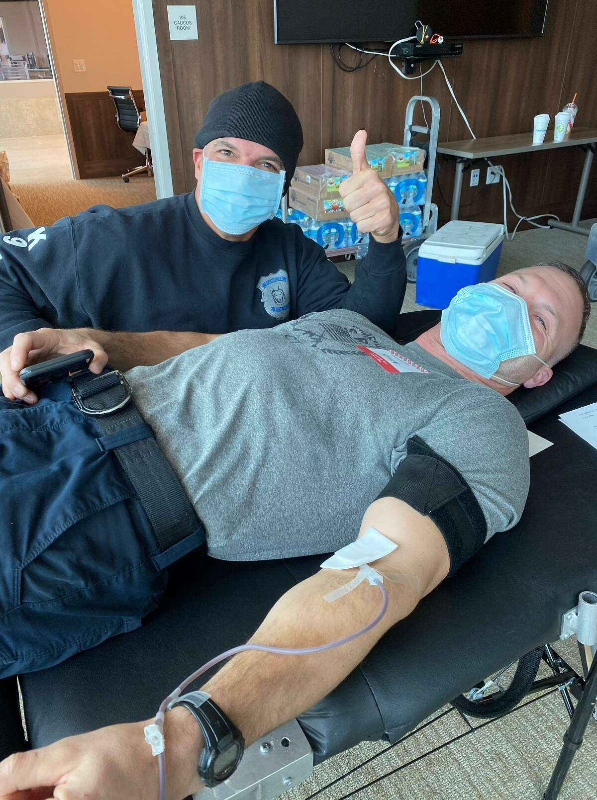 Lt. Doug Deiso and Sgt. Kevin Lynch (lying down) at the Stamford police and fire blood drive on Nov. 17, 2020.