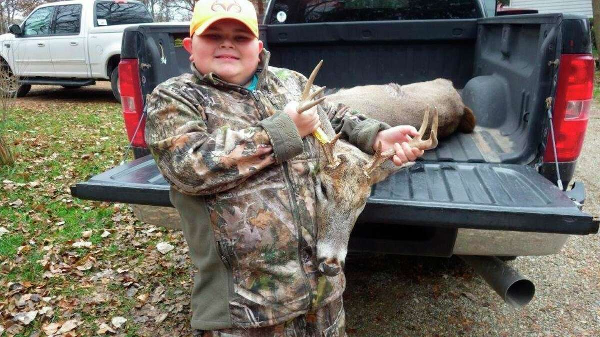 Logan Ruiz, 9, of Fairgrove, was very happy with the 8-pointbuck he shot near Mayville at daybreak on November 16 while hunting withhis grandfather, Kevin O'Dell. (Tom Lounsbury/Hearst Michigan)