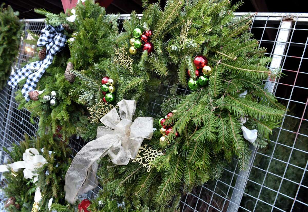 Examples of handmade wreaths are displayed by the Tyler Newkirk Craft Company at B & B Farms in West Haven in 2019.