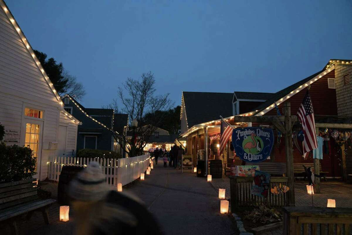 A view of the lighted shops and walkways at last year's lighted Olde Mistick Village. - In a first for the open-air village and shopping center, Olde Mistick Village in Mystic isd hosting a Holiday Lights Spectacular that promises to be the largest outdoor lights display in southern New England. That means a half-million lights decorating shops and restaurants at the village, which began adding the lights in stages Nov. 20 through Wednesday, Nov. 25.