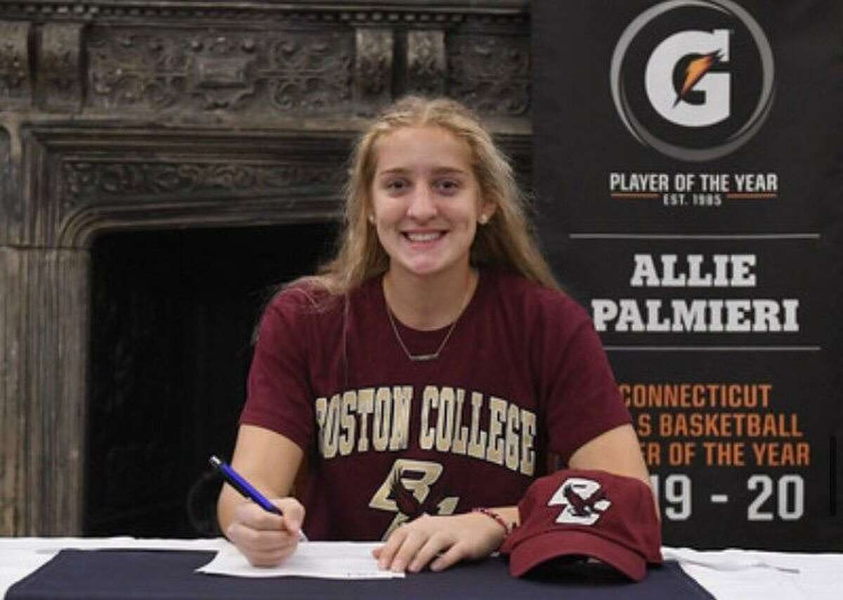 Trumbull resident Allie Palmieri signs her letter of intent to play basketball at Boston College.