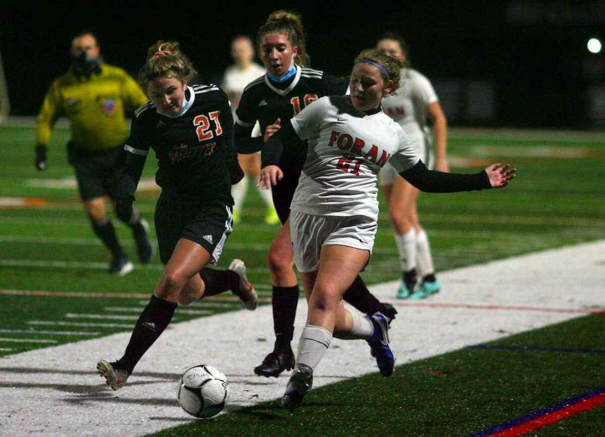 Mia Lowenberg for Foran looks to gain possession in the Lions' SCC divisional final with Shelton.