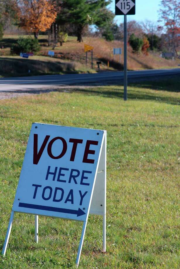 A sign outside of the Crystal Lake Township Hall on Nov. 3 lets people know it is a polling place. The township saw a huge increase in absentee ballot voting. (Photo/Colin Merry)