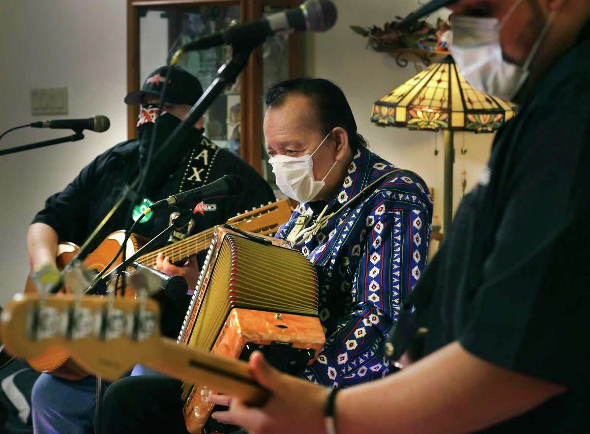 Flaco Jimenez, center, Max Baca, left, and Josh Baca of Los Texmaniacs performing earlier this year. Baca is currently hospitalized with COVID-19.