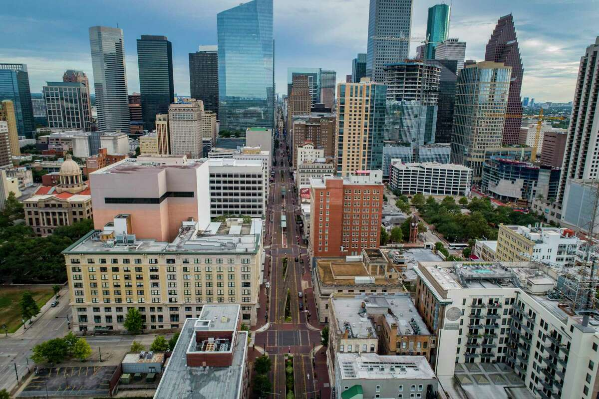 The Metro light rail line runs down Main Street on July 28, 2020, in downtown Houston. City Council on Nov. 18 approved a program to use Main Street for outdoor dining.