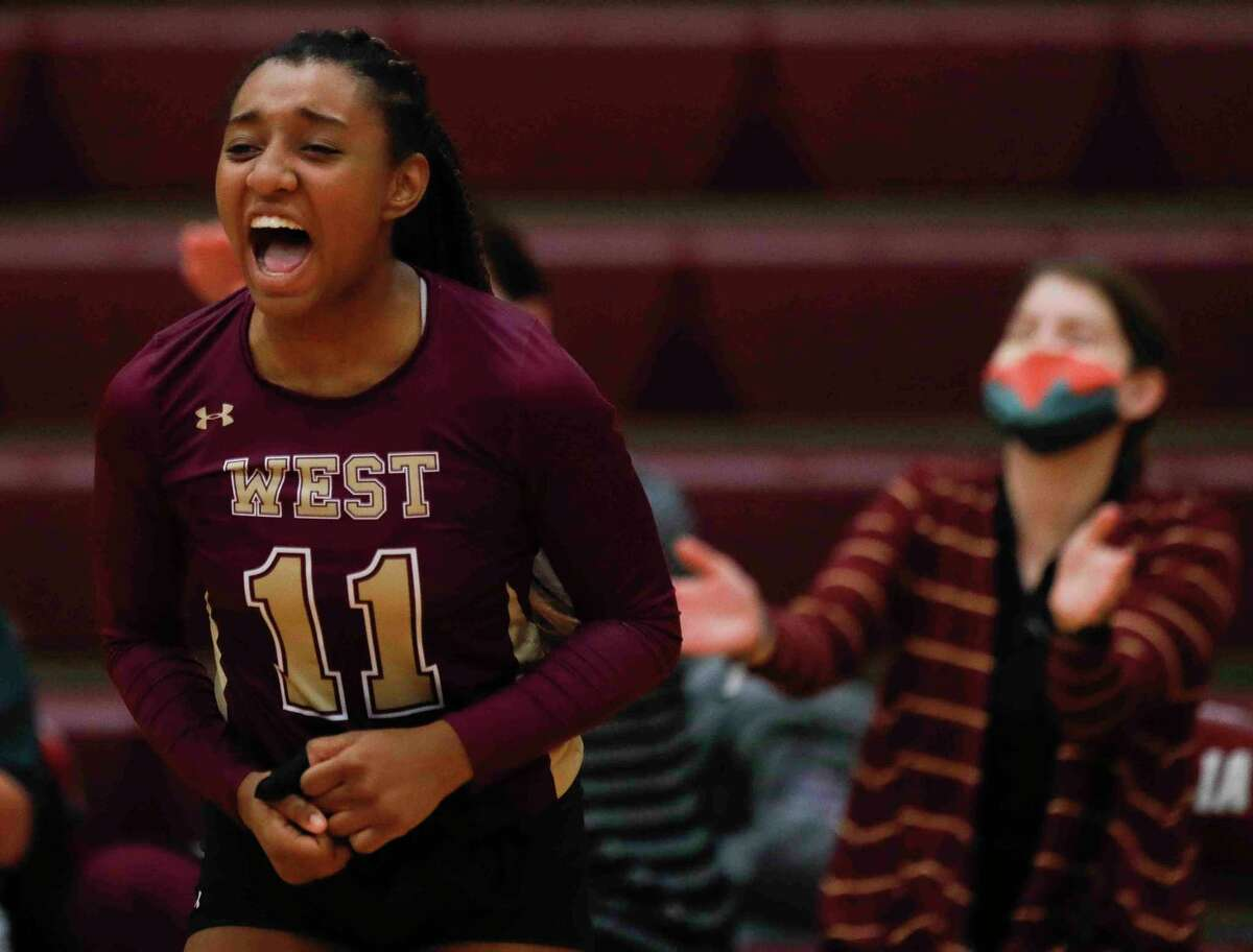 Magnolia West opposite side hitter Alexa Hayes (11) reacts after a three-set sweet of rival Magnolia during a District 19-5A high school volleyball match at Magnolia High School, Tuesday, Oct. 6, 2020, in Magnolia.