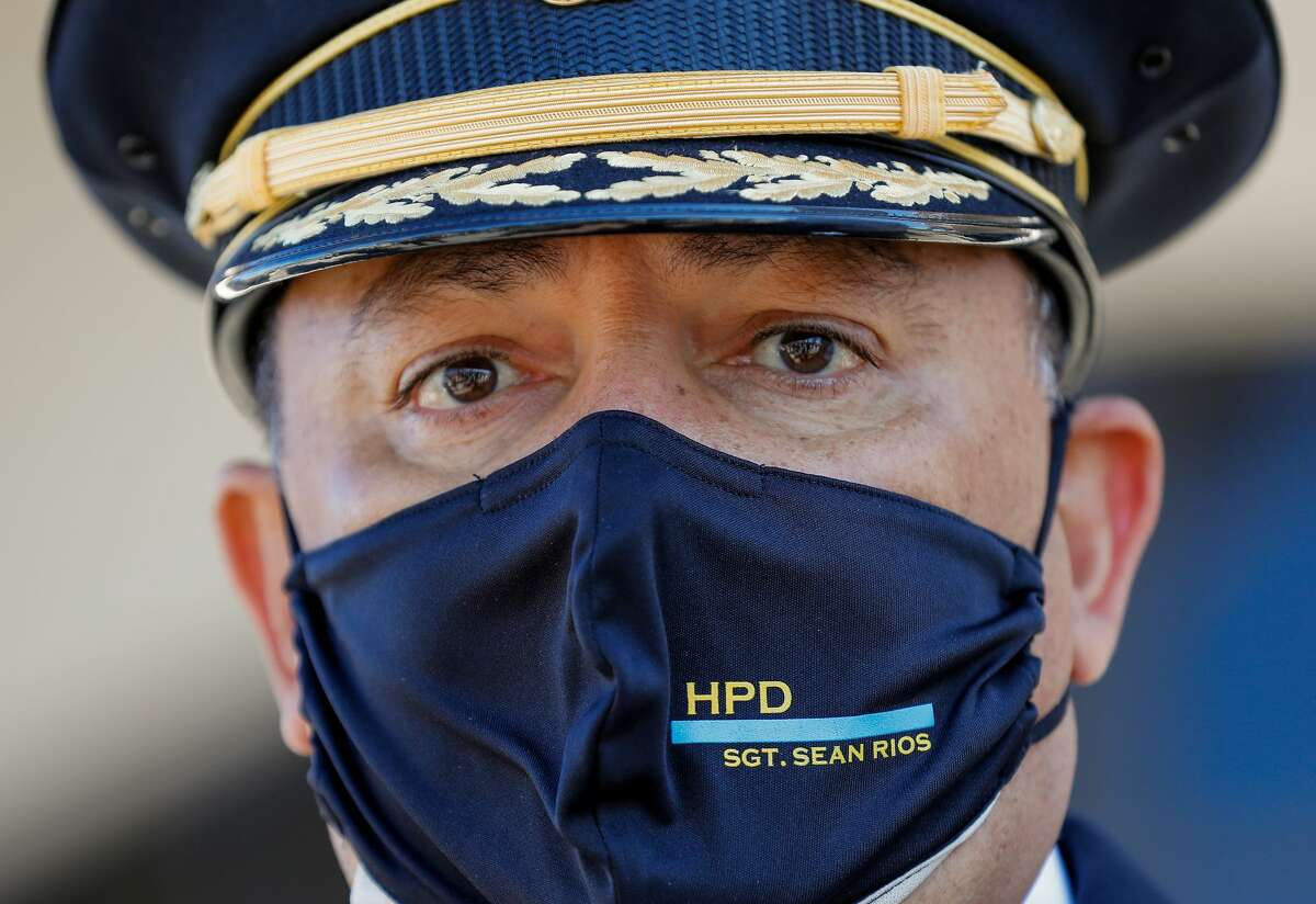 Houston Police chief Art Acevedo wears a face mask honoring Sgt. Sean Rios, while talking to reporters outside Grace Church Houston, where Rios' memorial service is taking place Wednesday, Nov. 18, 2020, in Houston. Rios was fatally shot on Nov. 9 while on his way to work.
