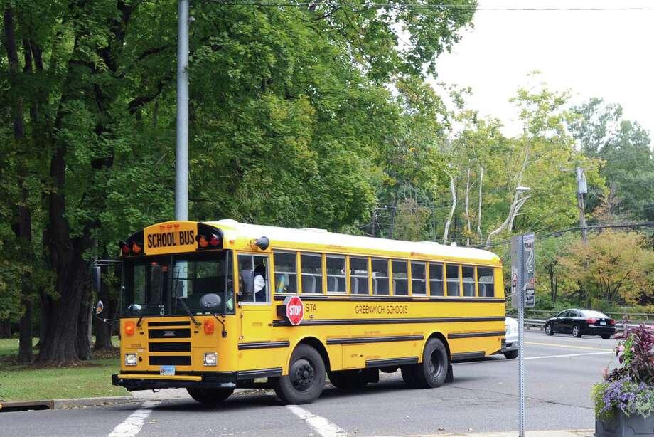 A Greenwich school bus turns onto Hillside Road in Greenwich, Conn., Thursday, Oct. 8, 2015. Photo: Bob Luckey Jr. / Hearst Connecticut Media / Greenwich Time