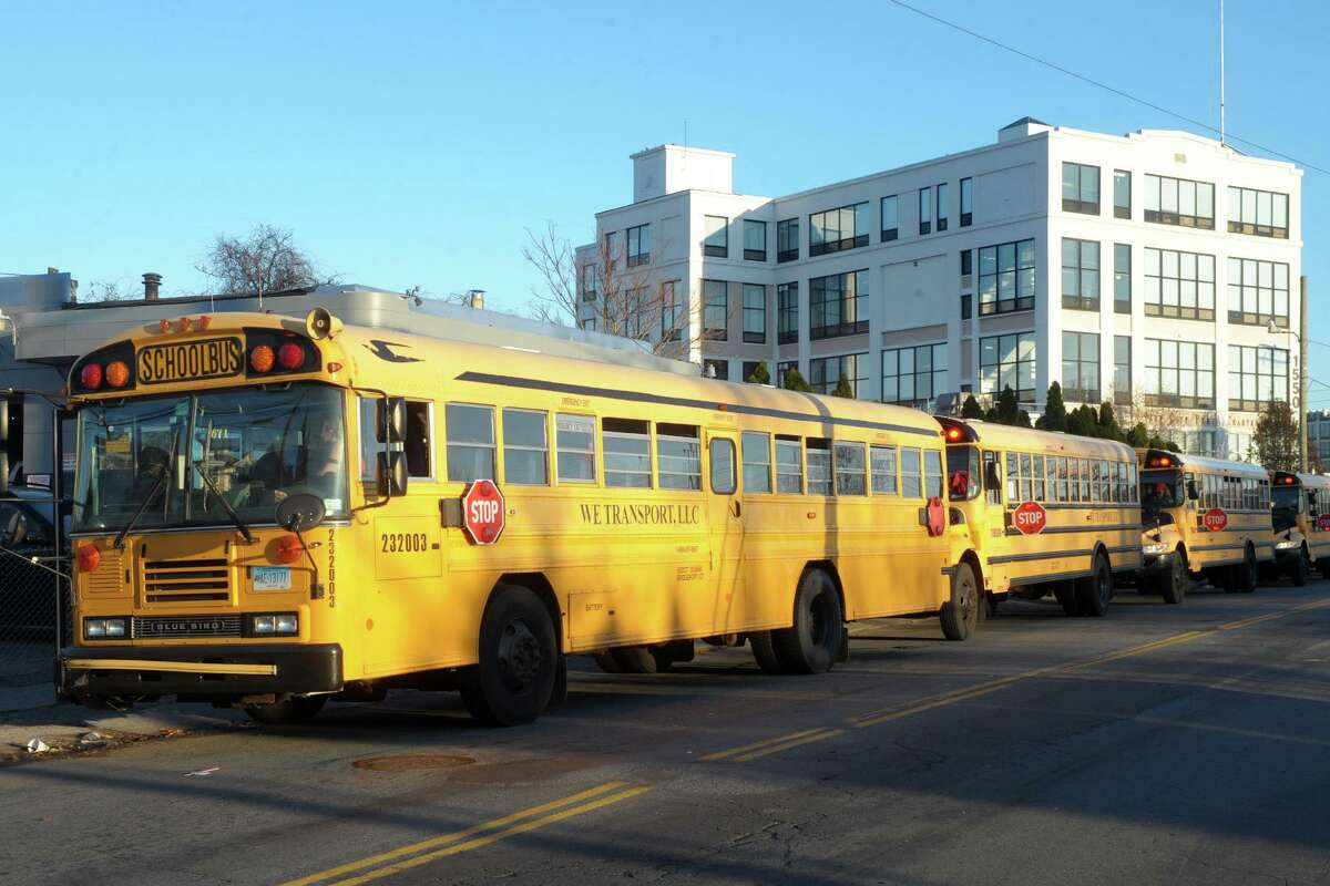 School buses line up along Mountain Grove Street at the end of the school day at Park City Prep Charter School, in Bridgeport last year.