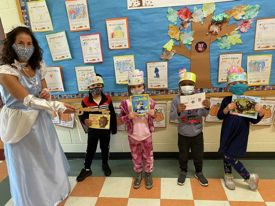 The kindergarten classes at Frenchtown Elementary School received the Key to the Reading Kingdom recently. Wearing a tiara, Principal Gina Prisco played the role of the Queen of the Reading Kingdom. Photo: Contributed Photo /