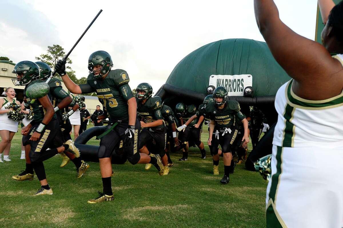 Legacy Christian Academy players run onto the field before playing Kelly Catholic. Photo taken Friday 9/7/18 Ryan Pelham/The Enterprise