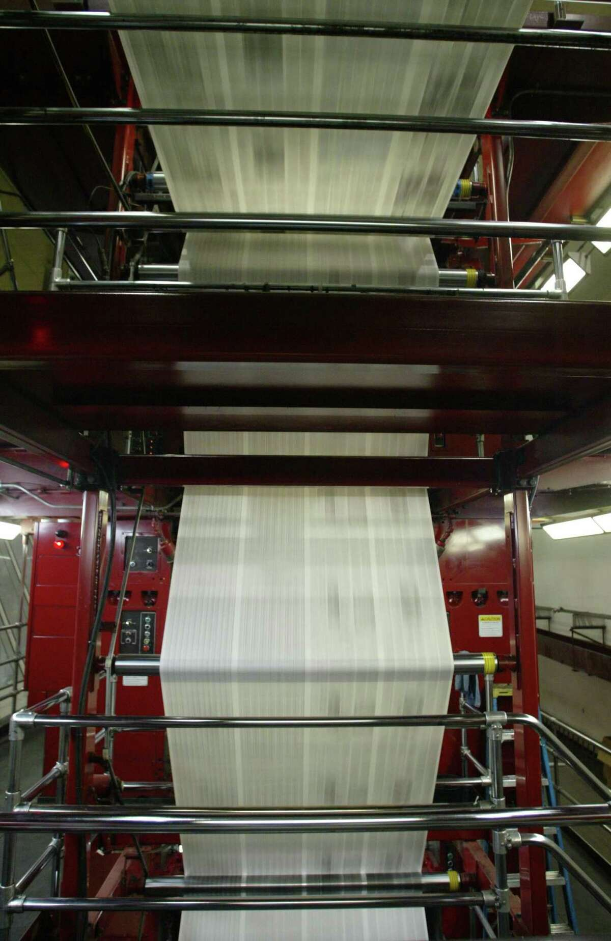 3-10-03 The Seattle Post-Intelligencer newspaper runs through a Goss press at the Times North Creek printing plant in Bothell.