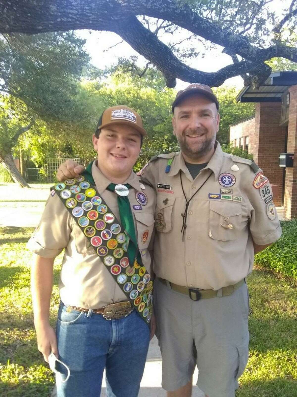 Benton Ward, 15, stands with his father, Brett Ward, scoutmaster of Troop 345. The troop's trailer packed with camping equipment was stolen from behind Northwood Presbyterian Church in early November.