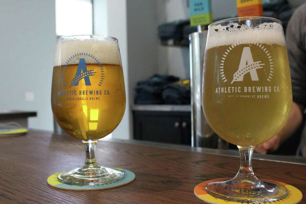 """The Run Wild IPA (left) brew from Athletic Brewing, named among the world's best in the 2020 installment of the International Beer Challenge. The Stratford company was named the top brewer in North America, with its Free Way IPA deemed the """"supreme"""" beer globally entered in the competition."""